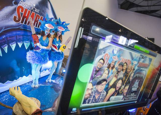 Models Megan Wilson, left and Cora Kelsey pose for a photo at the Aristocrat Sharknado photo booth during Global Gaming Expo at the Las Vegas Sands Expo and Convention Center on Tuesday , Sept. 27 ...