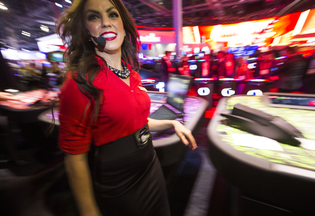 Dealer Katelyn Koval entertains guests in the Interblock Pulse Arena during Global Gaming Expo at the Las Vegas Sands Expo and Convention Center on Tuesday, Sept. 27, 2016. Jeff Scheid/Las Vegas R ...
