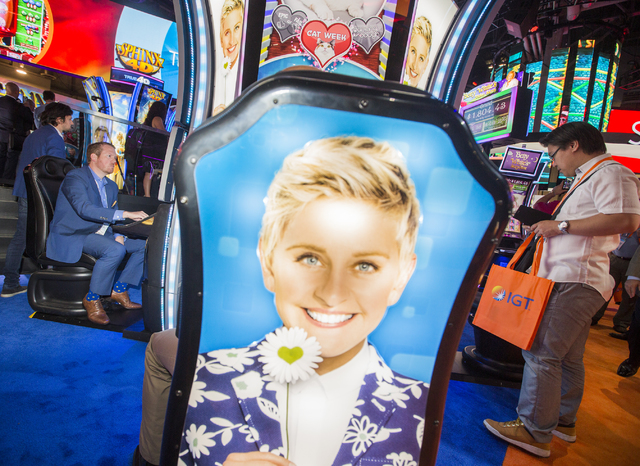 Men play the Ellen theme slot machine at the IGT booth during Global Gaming Expo at the Las Vegas Sands Expo and Convention Center on Tuesday , Sept. 27, 2016. Jeff Scheid/Las Vegas Review-Journal ...