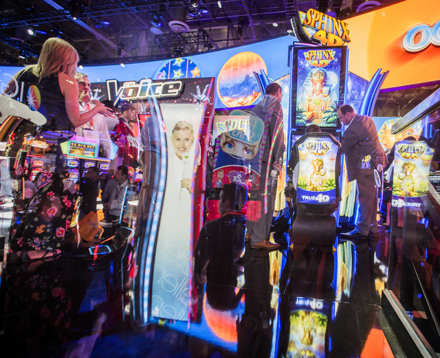 A kaleidoscope of light is seen while people look at slots in the IGT booth during Global Gaming Expo at the Las Vegas Sands Expo and Convention Center on Tuesday, Sept. 27, 2016. Jeff Scheid/Las  ...