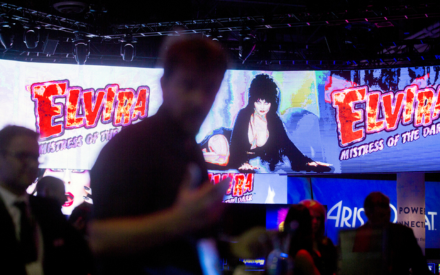A video screen promotes the Aristocrat Elvira themed slot machine during Global Gaming Expo at the Las Vegas Sands Expo and Convention Center on Tuesday, Sept. 27, 2016. Jeff Scheid/Las Vegas Revi ...