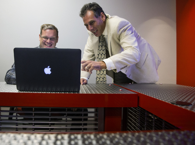 Josh Frank, right, meets with Steve Wells, organizer of a data science meet up group, about fraud prevention at The Innevation Center on Wednesday, Sept. 7, 2016, in Las Vegas. Frank is an expert  ...