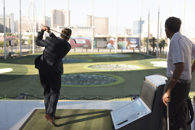 Shriners Hospitals for Children Tournament Director Patrick Lindsey hits golf balls at Topgolf's driving range during a media day for the tournament in Las Vegas, Monday, Sept. 26, 2016. The tourn ...