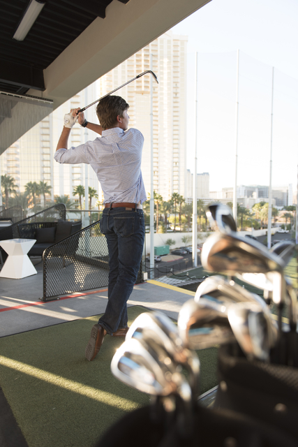 Shriners Hospitals for Children Open defending champion Smylie Kaufman hits golf balls at Topgolf's driving range during a media day for the tournament in Las Vegas, Monday, Sept. 26, 2016. The to ...