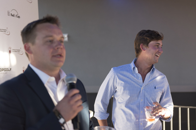 Shriners Hospitals for Children Open defending champion Smylie Kaufman, right, is introduced by Tournament Director Patrick Lindsey during a media day for the tournament in Las Vegas, Monday, Sept ...