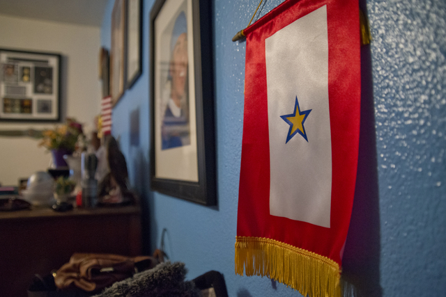 A gold star service flag hangs in the home of Marina Vance in Henderson May 14. Daniel Clark/View