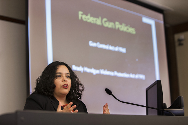Dr. Erika Marquez, director of social policy for the Kenny Guinn Center for Policy Priorities, speaks at a gun reform presentation at the William S. Boyd School of Law at UNLV on Wednesday, Sept.  ...
