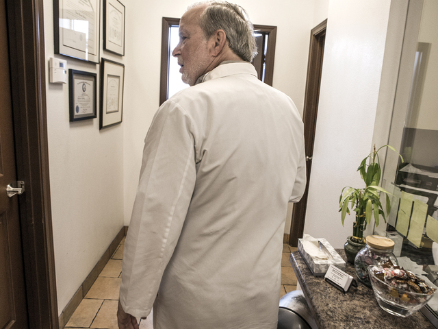Dr. James Gabroy walks the hallway of his office at 1535 W. Warm Springs Road in Henderson on Wednesday, Aug. 31, 2016.  (Jeff Scheid/Las Vegas Review-Journal Follow @jeffscheid)