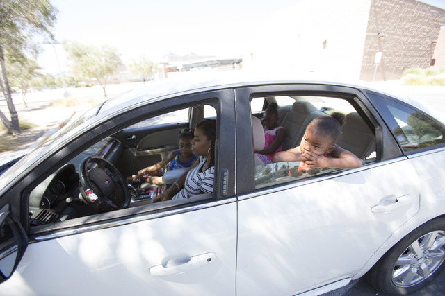 Erica Conner, 37, Sits In The Front Seat Of Her Ford Taurus With Her