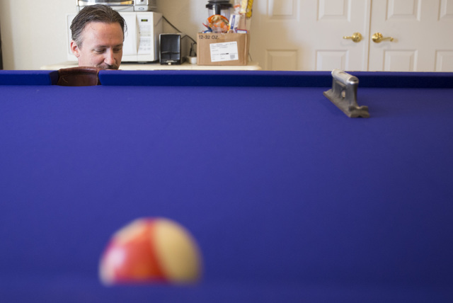 President of On Cue Billiards Kevin Knoke levels the pool table of his customer Jim MacMillan at MacMillan's residence in Las Vegas on Monday, Sept. 26, 2016. (Richard Brian/Las Vegas Review-Journ ...