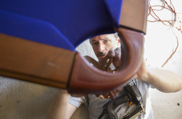 President of On Cue Billiards Kevin Knoke adjusts the corner pocket of a pool table for his customer Jim MacMillan at MacMillan's residence in Las Vegas on Monday, Sept. 26, 2016. (Richard Brian/L ...