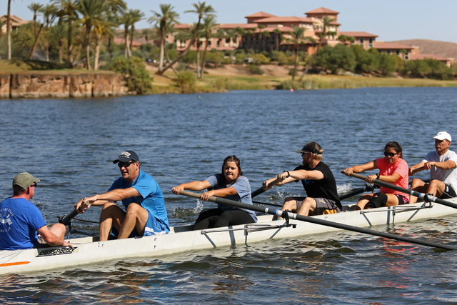 Coxswain Aaron Hastings, left, shouts during a Learn to Row class at Lake Las Vegas Sept. 17. Ronda Churchill/View