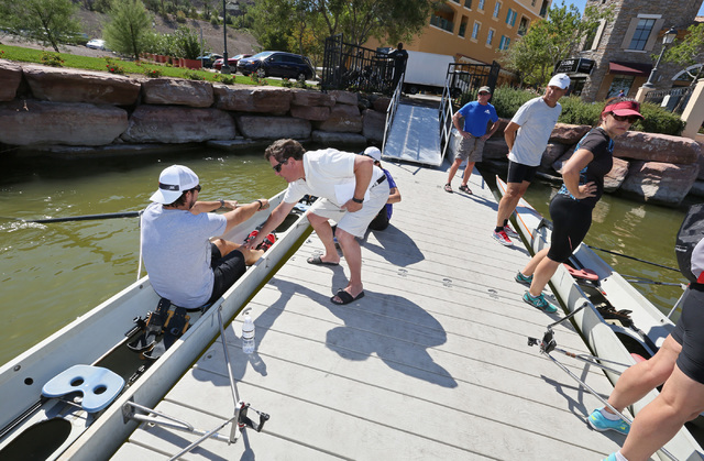 Jim Andersen, center, coaches crew member Brian Hawthorne, left, at Lake Las Vegas Sept. 17. Ronda Churchill/View