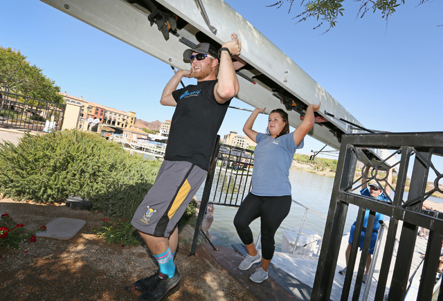 Crew members, from left, Daniel Chapman, Taylor Gangi and Matt McKnight carry the boat back to the boathouse after rowing at Lake Las Vegas Sept. 17. Crew coach Jim Andersen plans to lead competit ...