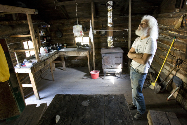 Kent Olson, 68, a historic log cabin restoration expert, checks out the Hidden Forest Cabin in the Sheep Mountains north of Las Vegas Tuesday, May 12, 2009. K.M. Cannon/Las Vegas Review-Journal Fo ...