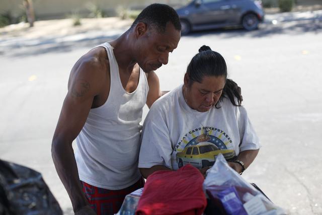 Carl Albert Graves and his fiancé Monica Salas organize their belongings on Saturday, Sept. 17, 2016, at their encampment behind EZ Pawn in Las Vegas. Rachel Aston/Las Vegas Review-Journal Fo ...