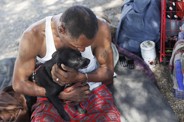 Carl Albert Graves holds his dog Chico on Saturday, Sept. 17, 2016, at his encampment he shares with his fiancé behind EZ Pawn in Las Vegas. Rachel Aston/Las Vegas Review-Journal Follow @rook ...