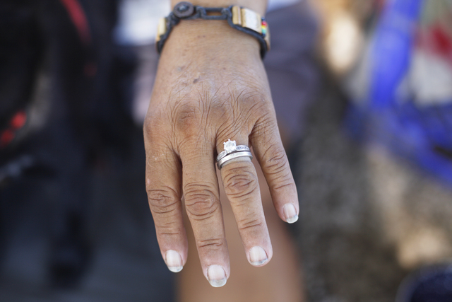 Monica Salas shows off her engagement ring on Saturday, Sept. 17, 2016, at his encampment she shares with her fiancé behind EZ Pawn in Las Vegas. Rachel Aston/Las Vegas Review-Journal Follow  ...