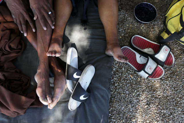 Carl Albert Graves and his fiancé Monica Salas rest on a blanket on Saturday, Sept. 17, 2016, at their encampment behind EZ Pawn in Las Vegas. Rachel Aston/Las Vegas Review-Journal Follow @ro ...