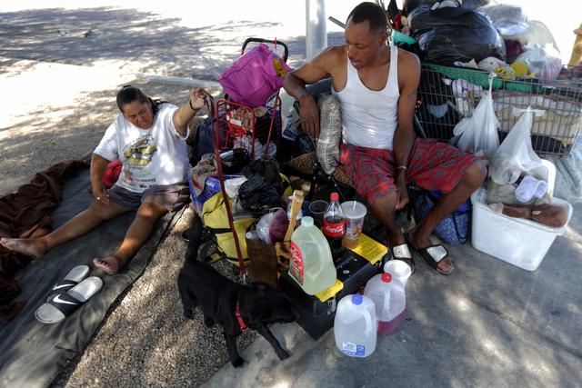 Monica Salas and her fiancé Carl Albert Graves rest at their encampment behind EZ Pawn on Saturday, Sept. 17, 2016, in Las Vegas. Rachel Aston/Las Vegas Review-Journal Follow @rookie__rae