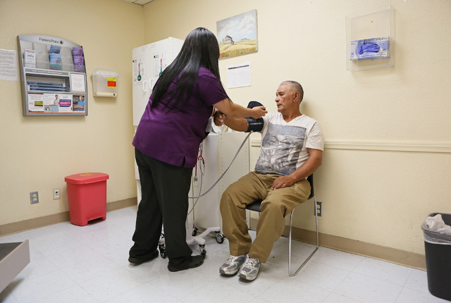 Patient Jesus Alvarado, right, has his blood pressure taken by medical assistant Alma Garcia at Nevada Health Centers facility on campus at The Salvation Army Friday, July 29, 2016, in Las Vegas.  ...