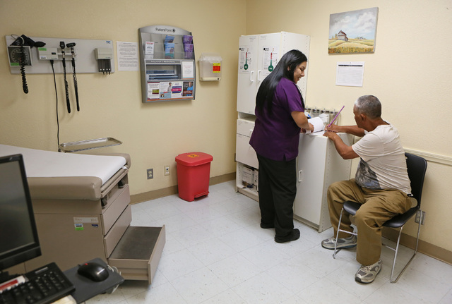 Medical assistant Alma Garcia, left, works with patient Jesus Alvarado at Nevada Health Centers facility on campus at The Salvation Army Friday, July 29, 2016, in Las Vegas. The center offers prim ...