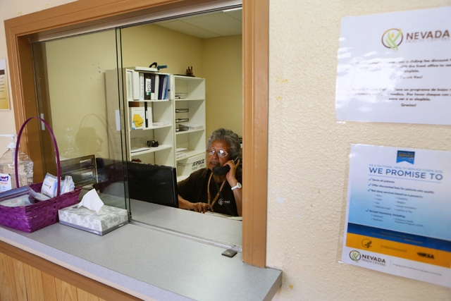 Front desk clerk Isidra Cervantes makes calls to patients at Nevada Health Centers facility on campus at The Salvation Army Friday, July 29, 2016, in Las Vegas. The center offers primary care to u ...