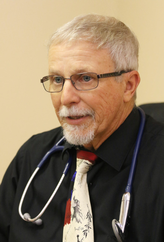Physicians assistant Brian Lane participates in an interview at Nevada Health Centers facility on campus at The Salvation Army Friday, July 29, 2016, in Las Vegas. The center offers primary care t ...