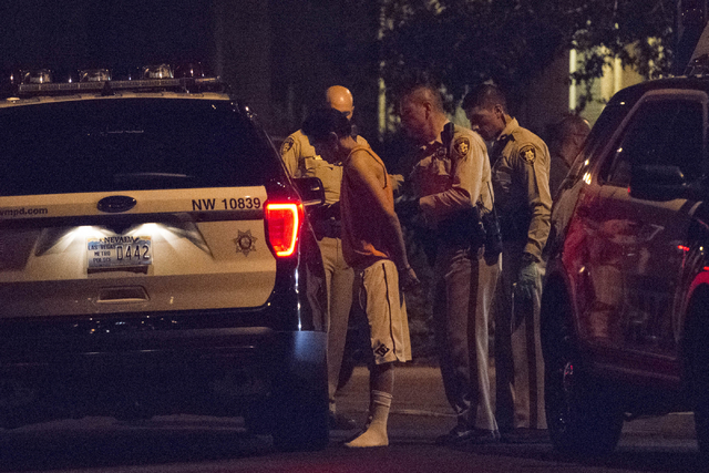 Las Vegas Police place a suspect into custody following a barricade situation near Napa Hills Drive and Piedmont Valley Ave. in Summerlin, Sunday, Sept. 25, 2016. Jason Ogulnik/Las Vegas Review-Jo ...