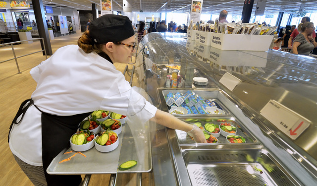 Nicole Willings adds salads to a refrigeration unit in the IKEA Restaurant at 6500 IKEA Way in Las Vegas on Saturday, Sept. 3, 2016. Bill Hughes/Las Vegas Review-Journal