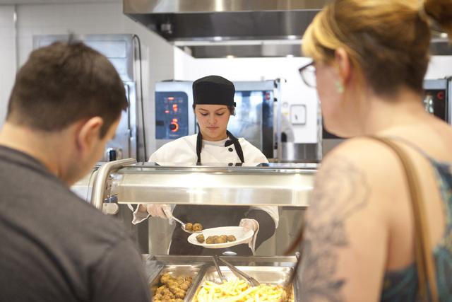 Stephanie Adams serves Michael Hagstrom and Chelsea Dauge food at the IKEA store in Las Vegas on Wednesday, Sept. 7, 2016. Loren Townsley/Las Vegas Review-Journal Follow @lorentownsley