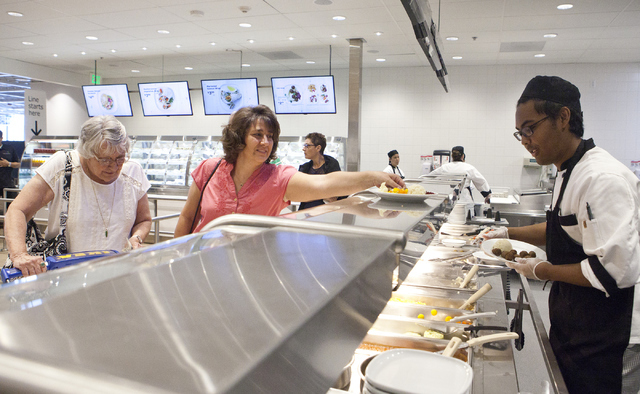 Marcelus Mantes, from right, serves Diana Jacobs and Janet Tocci food at the IKEA store in Las Vegas on Wednesday, Sept. 7, 2016. Loren Townsley/Las Vegas Review-Journal Follow @lorentownsley