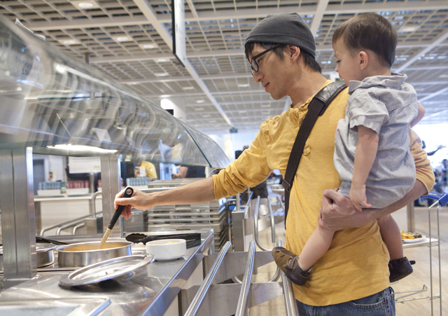 Patrick Wu and his son Ronan Wu, 2, get food at the IKEA store in Las Vegas on Wednesday, Sept. 7, 2016. Loren Townsley/Las Vegas Review-Journal Follow @lorentownsley