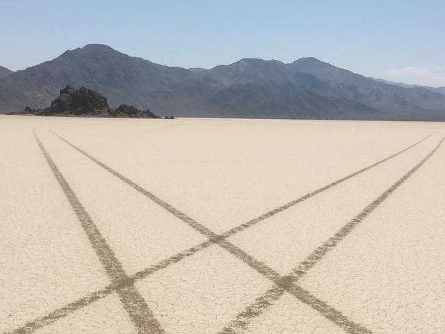 In this undated photo from Death Valley National Park, tire tracks from an illegal joyride crisscross Racetrack Playa near a formation called the Grandstand. (Courtesy of the National Park Service)
