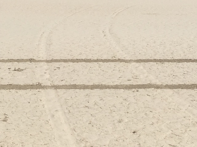 Fresh tire tracks cross the scars left by a previous illegal excursion onto Racetrack Playa in Death Valley National Park. Motor vehicles are prohibited on the dry lake bed, where damage from tire ...