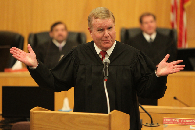 Nevada Supreme Justice Mark Gibbons speaks on behalf of his brother and newly appointed Nevada Court of Appeals Judge Michael Gibbons during his inaugural ceremony at the Clark County Government C ...
