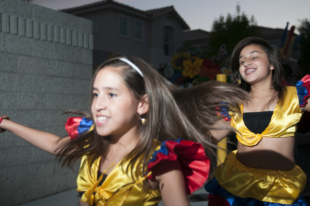 Maria Franco, left, and Valentina Galindez, rehearse a dance for a performance with cultural group Orgullo Colombiano, Thursday, Sept. 12, 2013, in Las Vegas, Nev.  (Erik Verduzco/Las Vegas Review ...