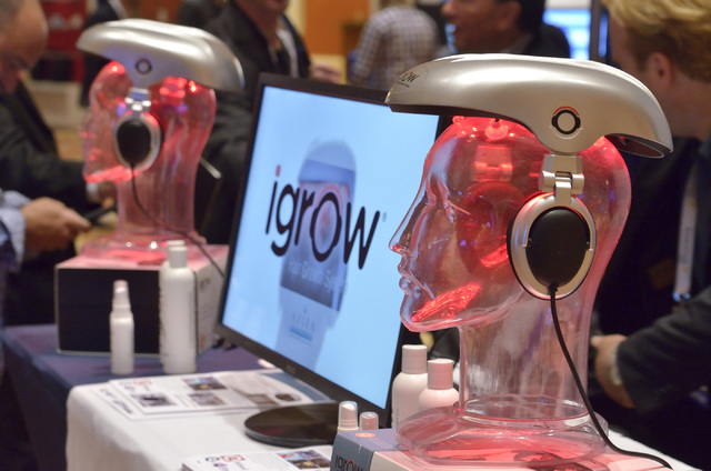 Part of the igrow Hair Growth System booth is shown at the 2016 Electronic Retailing Association D2C Convention in the Wynn Las Vegas on Wednesday, Sept. 14, 2016. (Bill Hughes/Las Vegas Review-Jo ...