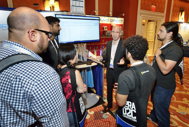 Joseph Gray, founder, president and CEO of media research company DRMetrix, talks with visitors to his booth at the 2016 Electronic Retailing Association D2C Convention in the Wynn Las Vegas on We ...