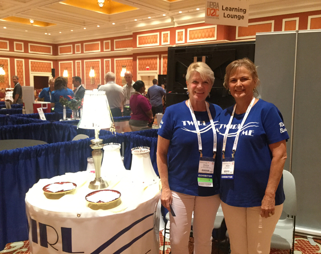 Co-owners of The Twirling Lamp Shade, Donna Stokes, left, and Maria Goodman present Stokes' invention, a lampshade that holds jewelry, at infomercial-industry convention D2C Thursday, Sept. 15, 20 ...