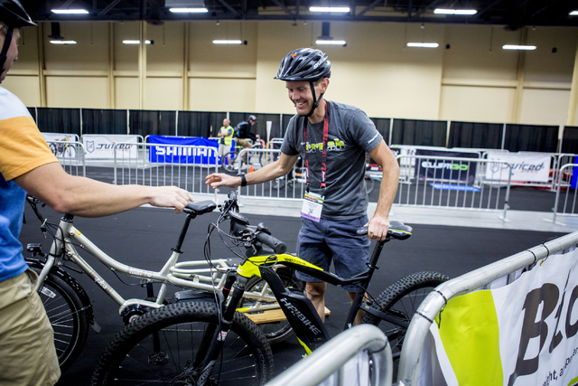Darren Balls, retail buyer, laughs after testing an eBike at the annual Interbike International Bicycle Exposition at the Mandalay Bay Convention Center, Wednesday Sept. 21, 2016, in Las Vegas. (E ...