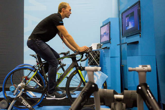 Menno Van Beelen, exhibitor, rides a stationary bike that connects to a virtual bike riding experience at the annual Interbike International Bicycle Exposition at the Mandalay Bay Convention Cente ...