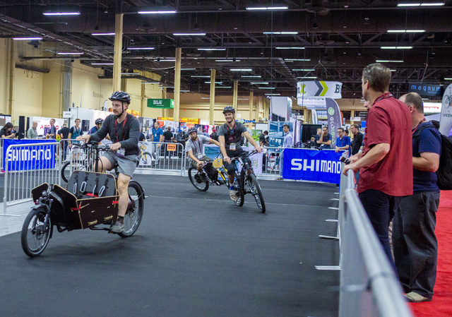 People test different brands of eBikes at a track at the annual Interbike International Bicycle Exposition at the Mandalay Bay Convention Center, Wednesday Sept. 21, 2016, in Las Vegas. (Elizabeth ...