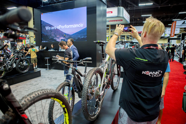 "Aaron ""Moose"" Reichert, retail buyer, takes photos of the Haibike ePerformance bikes at a track at the annual Interbike International Bicycle Exposition at the Mandalay Bay Convention Center, Wedn ..."