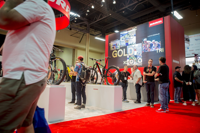 Retail buyers and exhibition hosts discuss at the annual Interbike International Bicycle Exposition at the Mandalay Bay Convention Center, Wednesday Sept. 21, 2016, in Las Vegas. (Elizabeth Page B ...