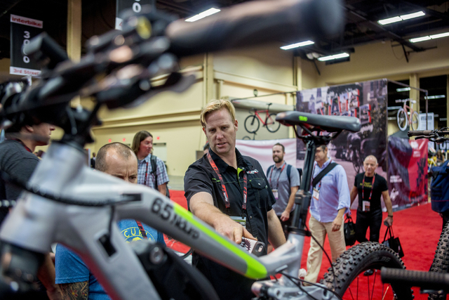"Aaron ""Moose"" Reichert, retail buyer, checks out potential  Haibike ePerformance bikes he might like to sell at his store in Hawaii at the annual Interbike International Bicycle Exposition at the  ..."