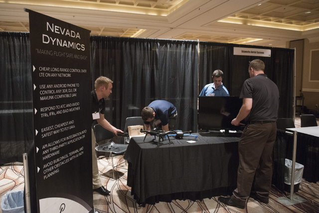 Nevada Dynamics, a Reno-based start-up sets up their display at InterDrone in the convention center at Rio hotel-casino in Las Vegas Wednesday, Sept. 9, 2015. (Jason Ogulnik/Las Vegas Review-Journal)