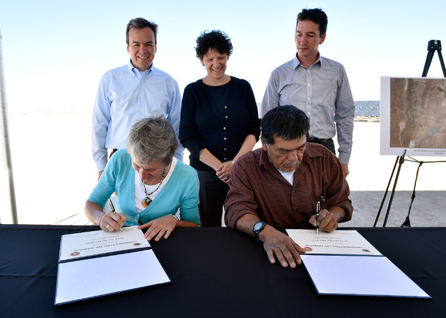Secretary of the Interior Sally Jewel, siting left, and Robert Tom, chairman of the Moapa Band of Paiute tribal council sign a record of decision for the future Aiya solar project at the Moapa Sou ...