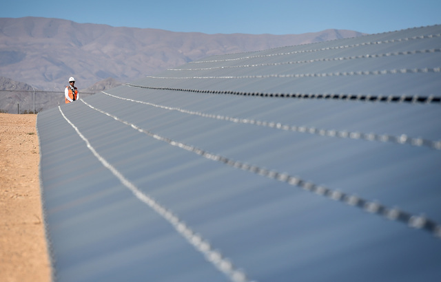 A man stands at the end of a row of solar panels at the Moapa Southern Paiute solar project 250 megawatt site, Thursday, Sept. 15, 2016, in Moapa. (David Becker/Las Vegas Review-Journal) Follow @d ...