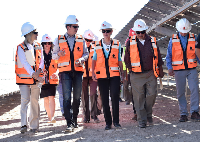 Secretary of the Interior Sally Jewel, center, tours the Moapa Southern Paiute solar project site with Brian Kunz, second left, First Solar's vice president of development and  Robert Tom, chairma ...